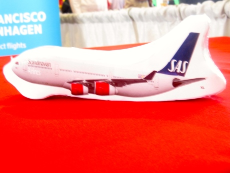 Fasten your seatbelts, please.  I thought this was a toy aircraft, fashions from plastic.  No, it's a specially wrapped & folded T-shirt, representing SAS Scandinavian Airlines!
