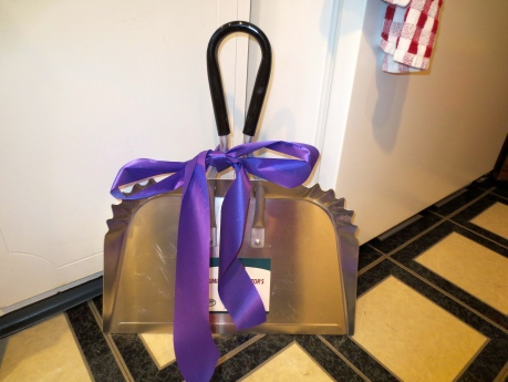 Collecting dust never got more attractive than this!  Industrial sized dust pan with purple ribbon-August 2013.