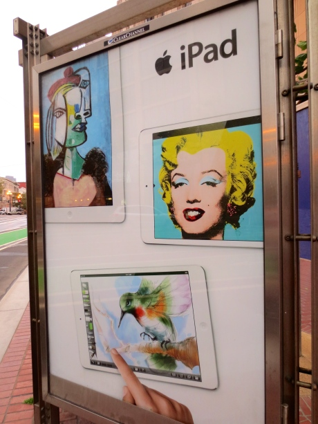 iPad is making use of the icon--The icon of the Church figured heavily as an influence on Andy Warhol in his depiction of those who were not Saints, but had @ least that Precious 15 Minutes of Fame.  This shows Marilyn Monroe in context with other images.