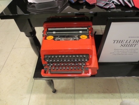 An Italian typewriter, well before the digital age, adds a splash of colour & a glimpse of the past in a 21st Century store seeking it's identity as a brand.