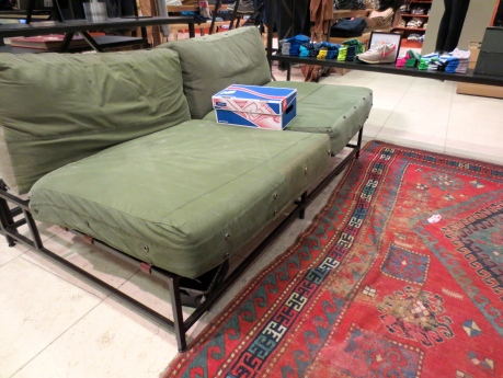 More mixed signals from J Crew--The sofa looks something from sidewalk pickup spree. The rug is a beauty, but I'd be scared to take it home next to a couch that looks as if it were left on the streets!  Scary!